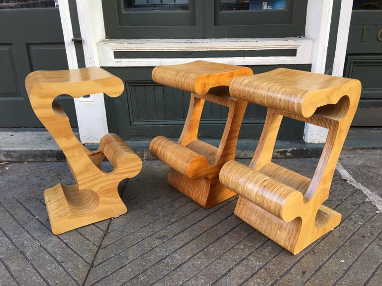 Joe Manus laminated plywood set of 3 stools. Cut-out shapes form the seat, footrest and base. Very solid construction with large scale seats! Designs probably date from the 1970s.