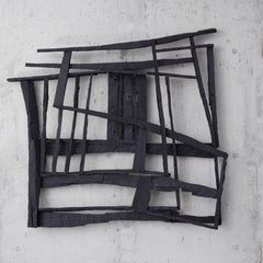 Sunlight Shot Through Barbed Wire, black abstract geometric wooden sculpture