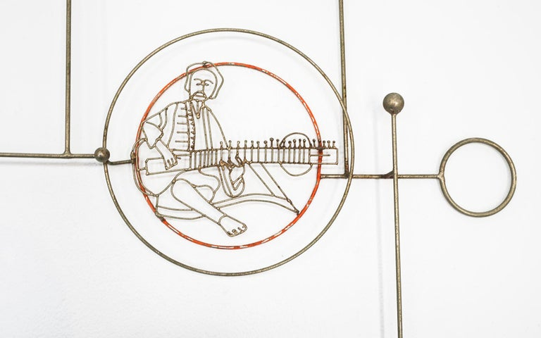 Rare 1970s Joseph Burlini metal wire abstract wall hanging sculpture with the image of sitar maestro Ravi Shankar. If you are a fan of the Shankar family of musicians, including daughter Nora Jones then this is a must have!