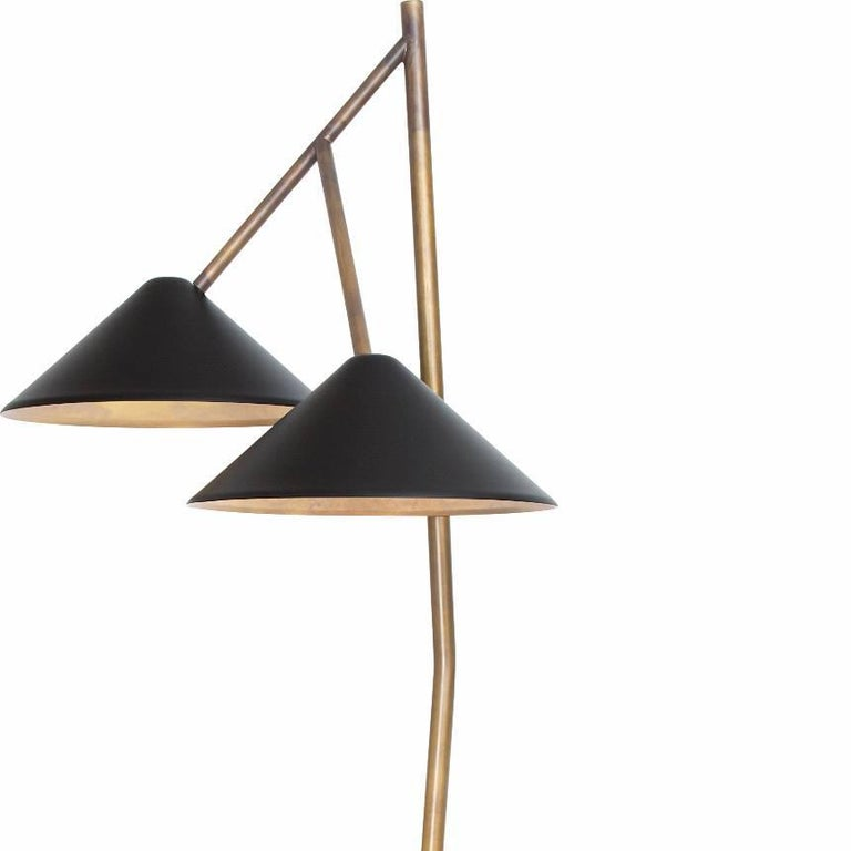 Floor lamp model Grenverk designed by Johan Carpner and manufactured by Konsthantverk.  The production of lamps, wall lights and floor lamps are manufactured using craftsman's techniques with the same materials and techniques as the first