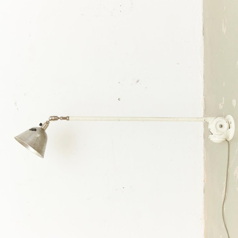 Telescopic wall lamp designed by Johan Petter Johansson. Manufactured by Triplex, (Sweden), circa 1930. Aluminium and steel.  In good original condition, with minor wear consistent with age and use, preserving a beautiful patina.