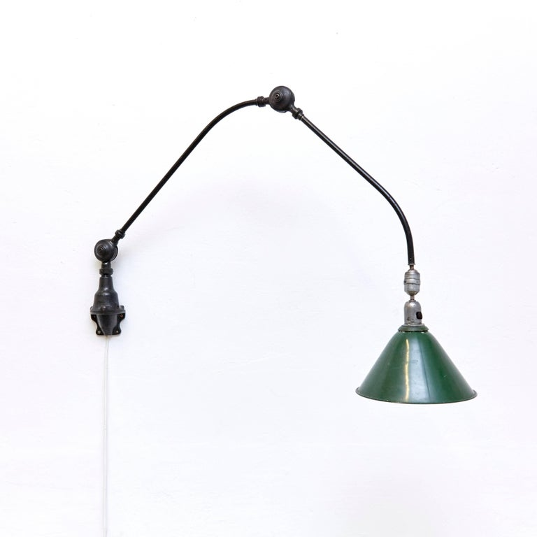 Wall lamp designed by Johan Petter Johansson. Manufactured by Triplex (Sweden), circa 1930. Aluminium and steel.  Measures: Height 94 x width 123 cm, 26.5 diameter  In good original condition, with minor wear consistent with age and use,