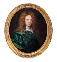 17TH CENTURY ENGLISH OIL PORTRAIT OF A YOUNG GENTLEMAN IN A GREEN SILK CLOAK.