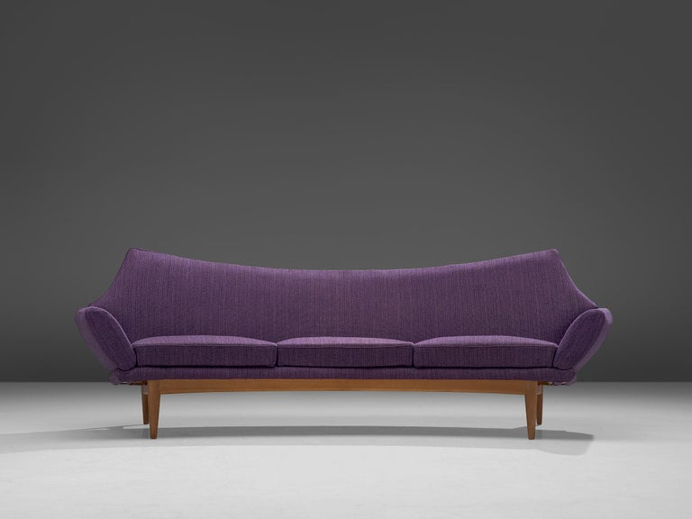 Johannes Andersen for TrensumsFatöljfabrik, sofa, fabric and oak, Sweden, 1960s  Swedish three-seat sofa designed by Johannes Andersen in the 1960s. The curved sofa features a striking design with almost complete absence of straight lines. The