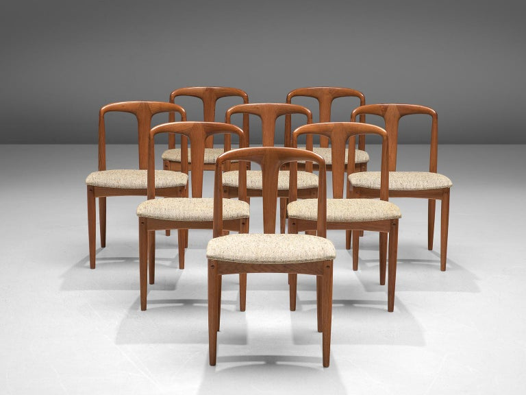 Johannes Andersen for Uldum Møbelfabrik, 'Juliane' set of 8 dining chairs, teak and fabric, Denmark, 1960s.