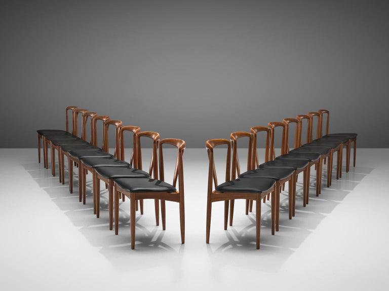 Johannes Andersen for Uldum Møbelfabrik, 'Juliane' set of 16 dining chairs, teak and leatherette, Denmark, 1960s  This large set of 16 dining chairs is designed by Danish Johannes Andersen and produced by Uldum Møbelfrabrik in Denmark. The set is