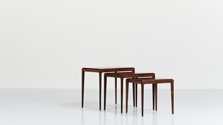 Set of three nesting tables, by Danish designer Johannes Andersen for CFC Silkeborg. Upper table decorated with ceramic tiles. Excellent general condition. The dimensions entered are for the largest table, Denmark, circa 1960.