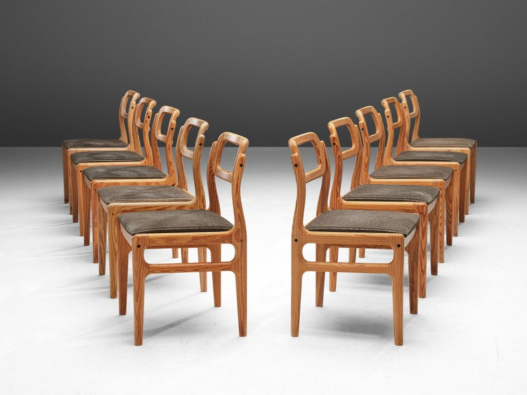 Johannes Andersen forUldum Møbelfabrik, set of 10 dining chairs, Oregon pine, fabric, Denmark, 1960s  A Scandinavian Modern set of dining chairs, designed by Johannes Andersen in the 1960s. Executed in Oregon pine, the frames are modest and curved