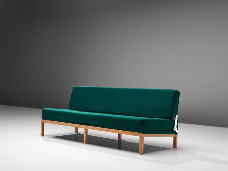 Johannes Spalt for Wittmann, green fabric, teak, Austria, 1960s.  This Austrian daybed is named 'Constanze'. This early model, with teak frame and green upholstery is wonderfully balanced in its color palette. The elegant slim legs create an open