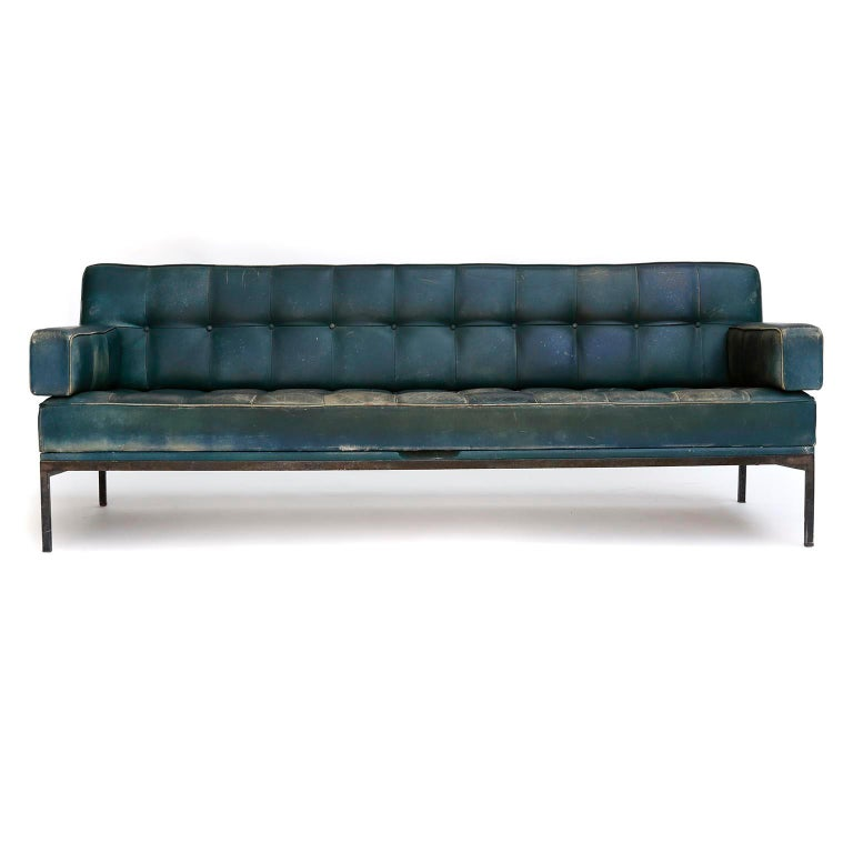 A freestanding tufted sofa named 'Constanze' (engl. Constance) designed by Prof. Johannes Spalt for Wittmann, Austria, manufactured in midcentury. Johannes Spalt designed this convertible daybed in 1961. This is a rare version with armrests. The