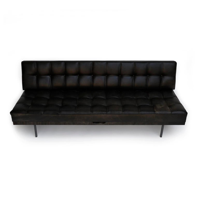 A freestanding tufted sofa named 'Constanze' (engl. Constance) designed by Prof. Johannes Spalt for Wittmann, Austria, manufactured in midcentury. Johannes Spalt designed this convertible daybed in 1961. The black leather is in very good condition