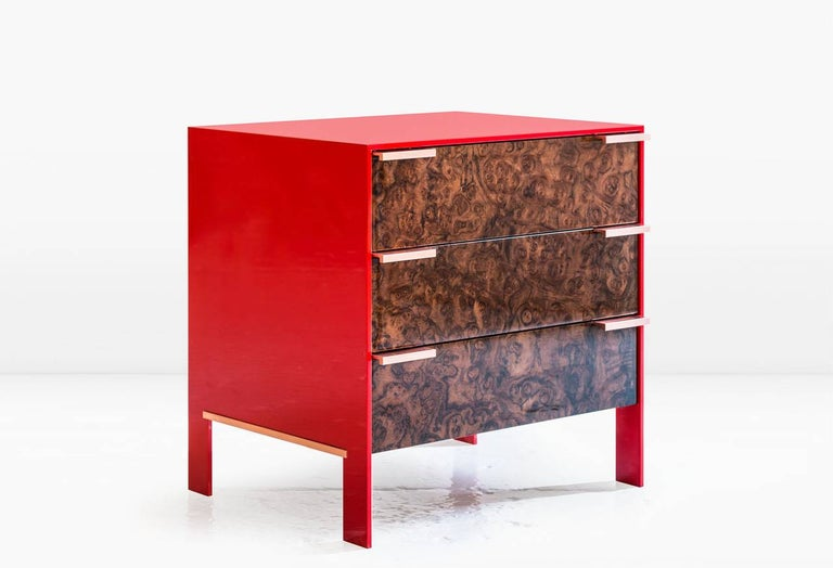 The Johansson cabinet - small has a skin of 1/2 inch lacquered aluminum encasing a cabinet constructed of highly polished wood veneer exteriors and solid wood interiors. Doors have solid metal pulls. Like all KGBL cabinetry, this piece is finished