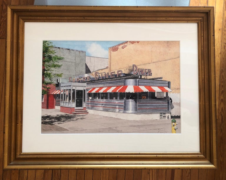 Watercolor by nationally renowned artist John Baeder. Baeder is an American realist widely recognized for his roadside diner paintings. This work is framed. Unframed visible 17 x 25 inches, framed dimensions with mat are 29 1/4 37 3/4 inches. Signed