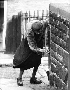 Lady Scrubbing Gate Post, Nelson, 1960 - John Bulmer (Photography)