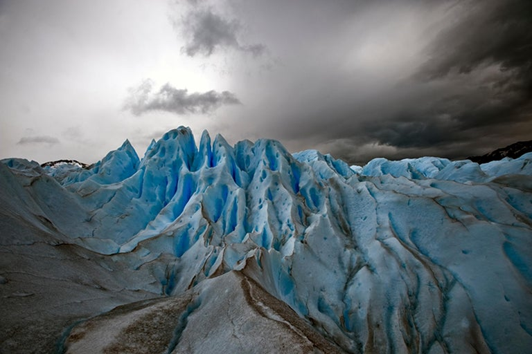 John Conn Landscape Photograph - Patagonia #51, Iceberg, Limited Edition Photograph, Blue, Black, unframed
