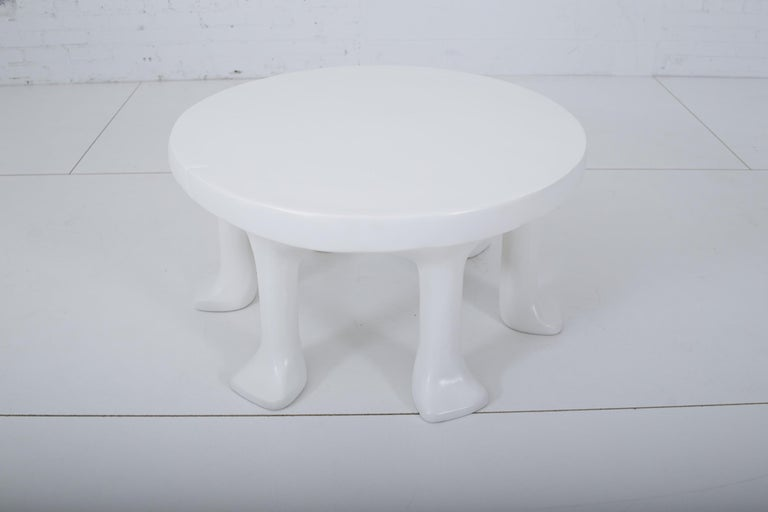 """John Dickinson African leg coffee table. Round table with 6 animal paw legs. Very heavy. Cast of glass fiber reinforced concrete. """"John Dickenson"""" signature on underside. 2012 production for Sutherland."""