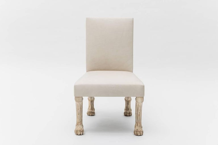 John Dickinson's legendary Etruscan Chair is covered in a parchment leather with wooden legs in an ivory craquelure finish. An example of this iconic design is featured in the permanent collection of the San Francisco MoMA. Heralded as one of the
