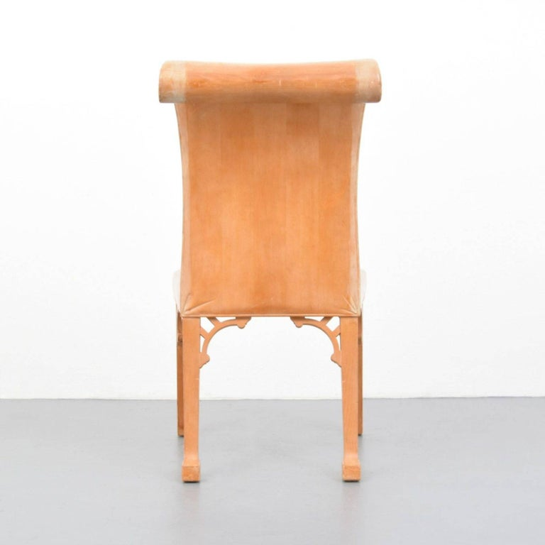 Created in 1969 as a prototype this carved chair in exaggerated classical style, epitomizes Dickinson's love of form and fantasy. Lending his love of the ancient world with 20th Century style. The chair is carved to resemble upholstery, with hints