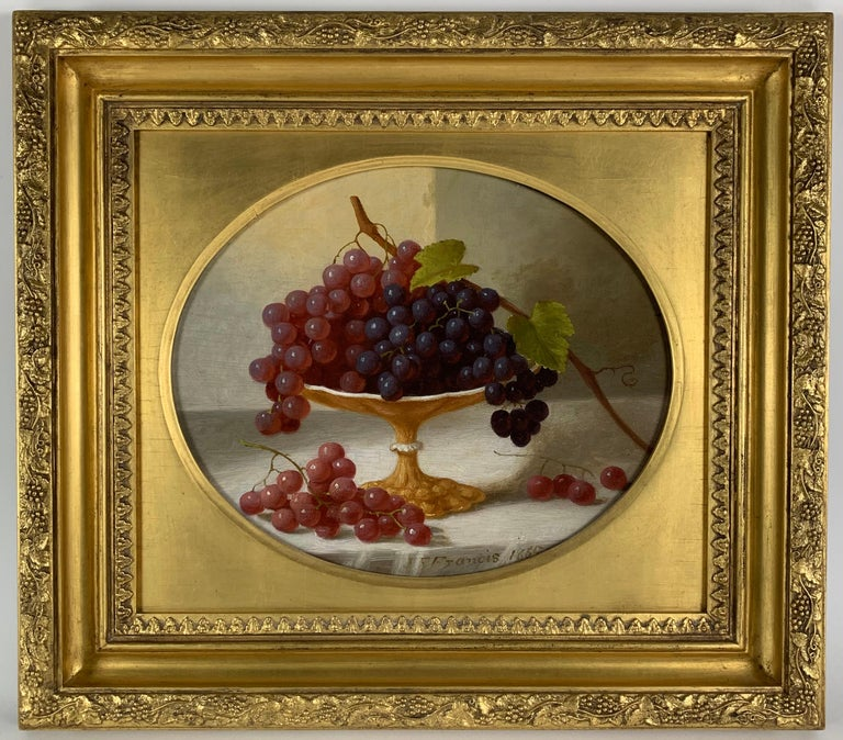 JOHN F. FRANCIS (1808-1886) Cakes and Cider, 1865 Oil on panel 9 ¼ x 11 ¼ inches (oval) Signed and dated at lower right:  J. F Francis 1865 Signed and dated verso Eli Wilner frame  PROVENANCE Collection of Mr. and Mrs. Philip F. Newman  By family