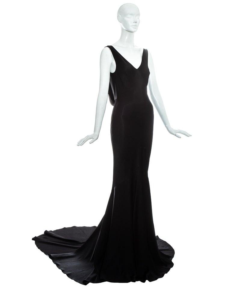 John Galliano black satin bias cut trained evening dress with draped panel on open back.  Fall-Winter 1995