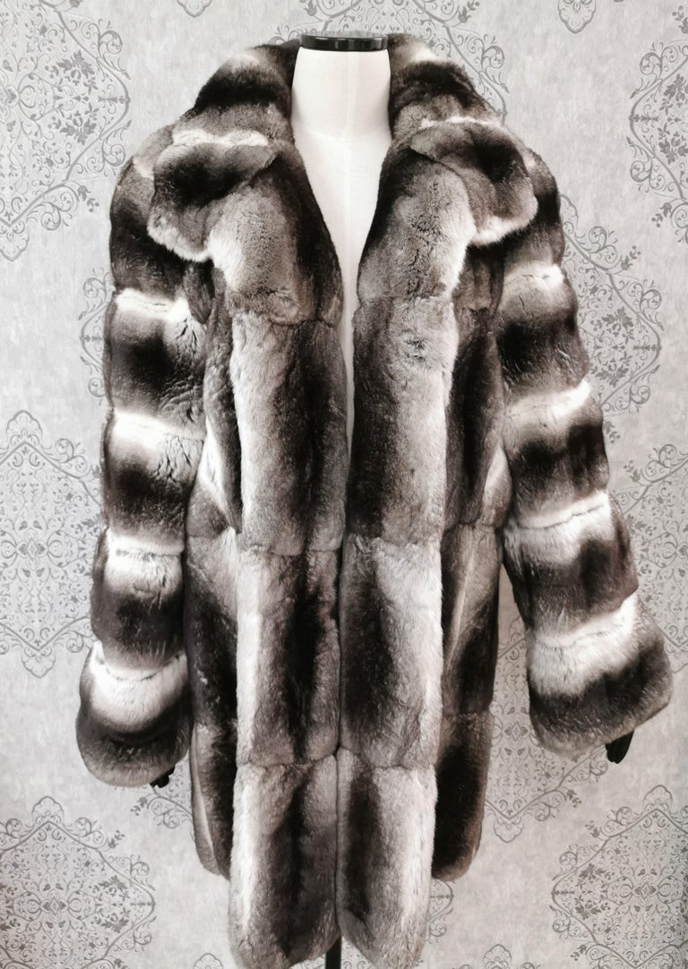 John Galliano Grey Chinchilla Fur Three-Quarter Length coat   Short collar, straight sleeves, dual seam pockets at hips and German hook-and-eye closures at front  Made in France  SIZE (16) (equivalent of Size L)  Measurements  Length 35