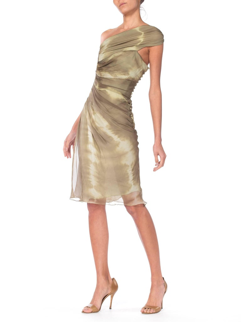 Gorgeous dress in silk built on an inner bodice for a structured yet sensual fit. Wonderfull detail work to the chiffon gathered on one side which creates an elegant flow with a classic row of Galliano buttons up the left side.