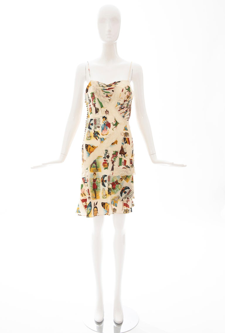 John Galliano for Christian Dior Runway, Spring 2002, silk and lace printed dress with all-over Americana & butterfly stamps, spaghetti straps, cutout accents, single flap pocket and multi-button closures at side.   FR. 38, US. 6  Bust: 30, Waist: