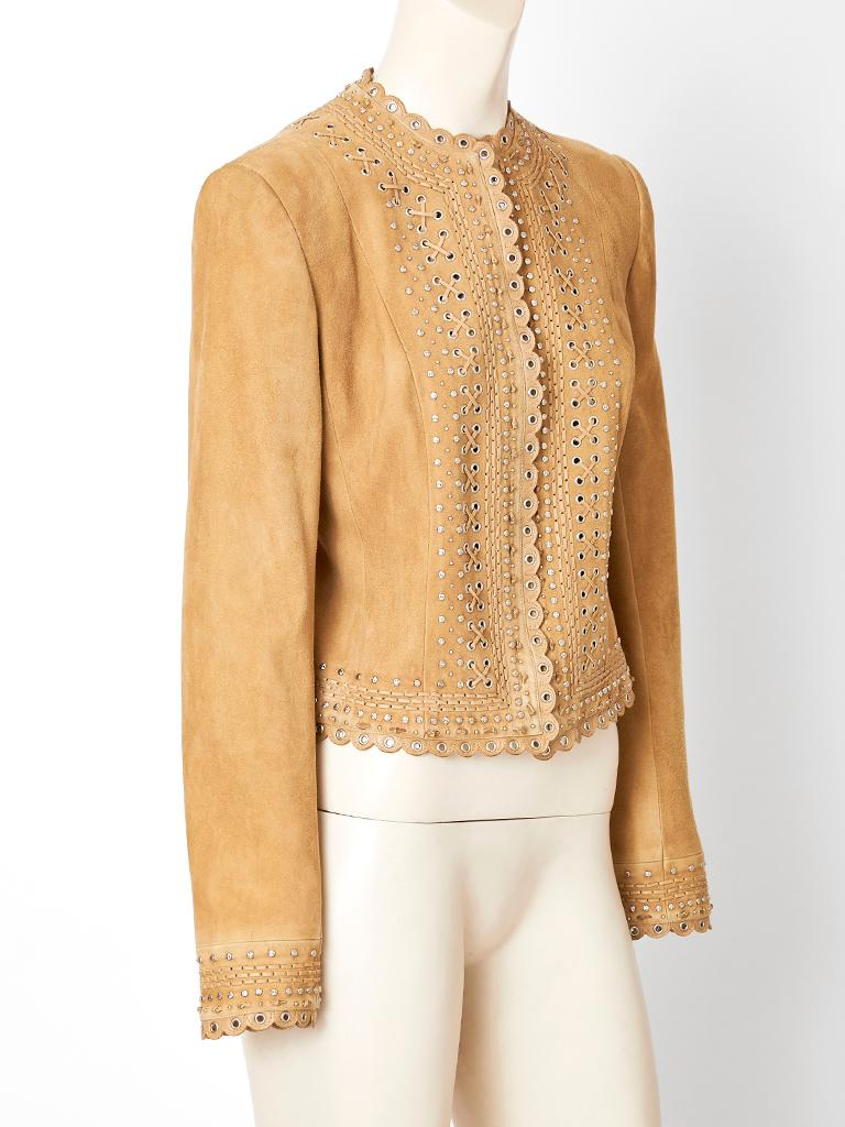 Camel tone, suede, fitted jacket designed by John Galliano for the house of Dior.  Jacket is collarless with small scallop edging at the neckline, center front, hem and sleeves. Center front hidden zipper closure. Fine grommets decorate the center