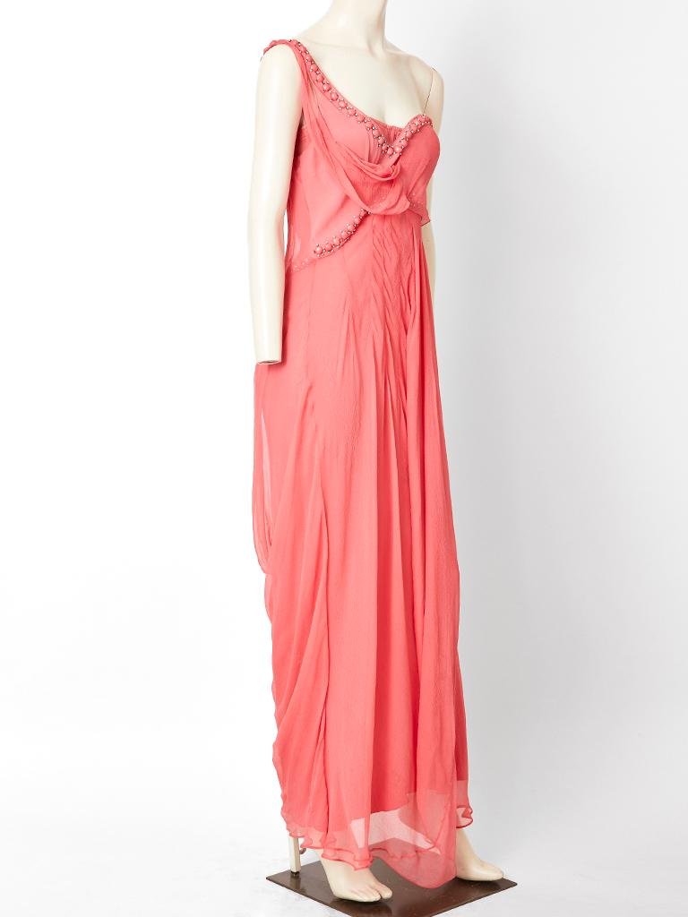 John Galliano for Christian Dior, coral tone, layered, silk georgette, one shoulder, empire waist, gown, having beading and rhinestone embellishment across the neckline and bust. Dress has signature Galliano bias cut.