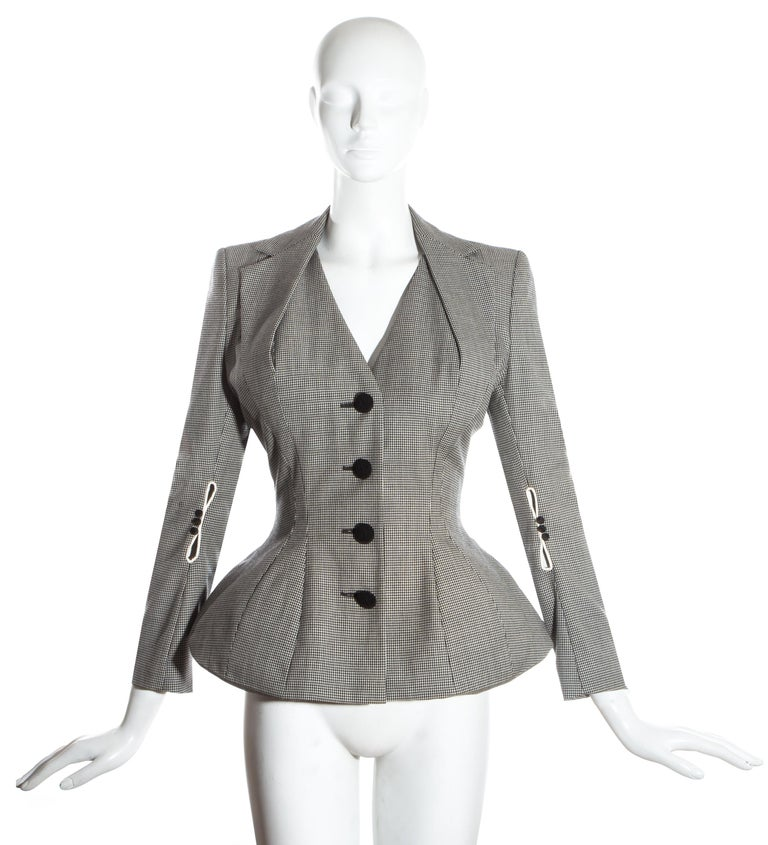 John Galliano hound's tooth check wool jacket with padded shoulders, hips and halter-neck style lapel.    'Pin-up/Misia Sert' collection, Spring-Summer 1995