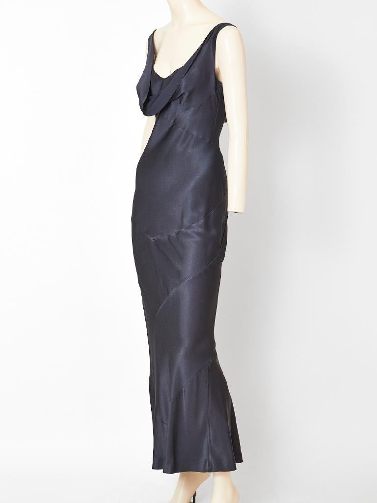 John Galliano, satin back crepe, bias cut evening dress in a midnight blue. Neck is open with some cowling, front and back. There is