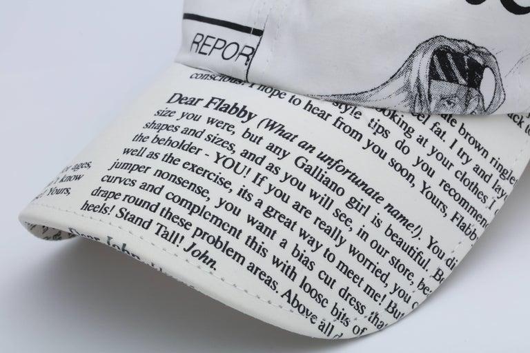 John Galliano iconic newspaper print cap.