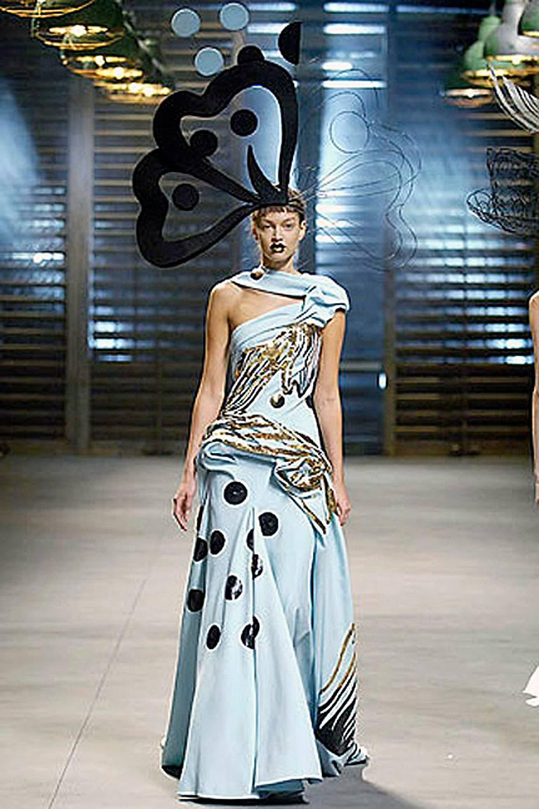 John Galliano's 2007 S/S collection made a highly visual splash and the finale featured elaborate and luxuriously draped patterned gowns.  The finale gowns, fashioned of creme silk crepe, were intricately styled and pleated, utilizing interesting,