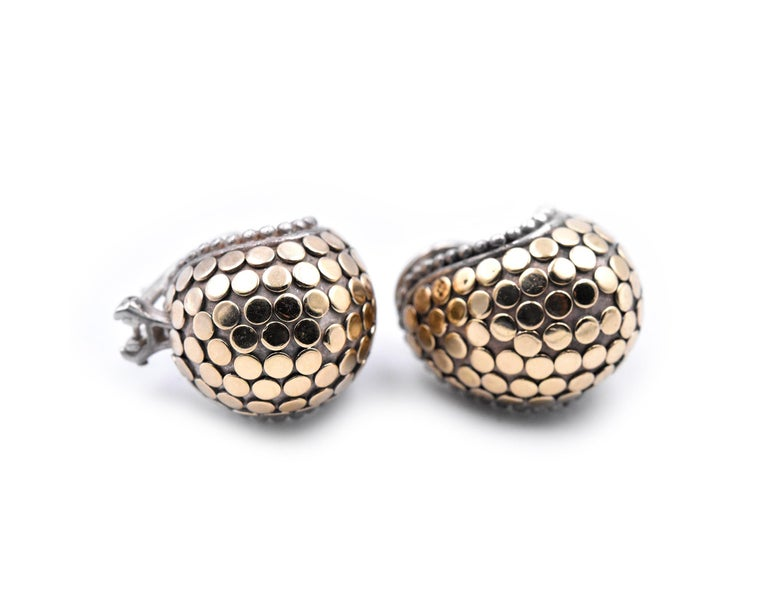 Designer: John Hardy Material: sterling silver and 18k yellow gold Dimensions: earrings measure 14.13mm in diameter Fastenings: post with omega back Weight: 16.51 grams