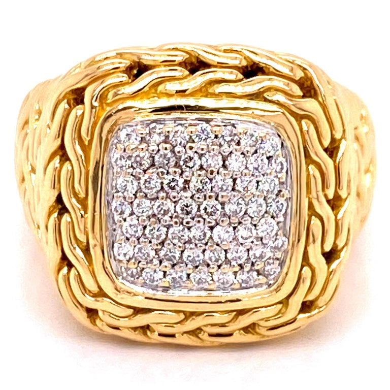 Beautiful diamond ring by designer John Hardy. The ring is crafted in textured 18 karat yellow gold and features a center of pave set round brilliant cut diamonds. (.50 CTW). The ring is size 5 (can be sized).