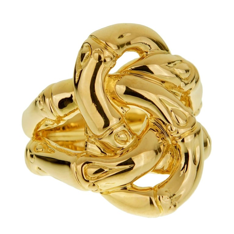 An iconic design by John Hardy showcasing a double bamboo knot in 18k yellow gold.