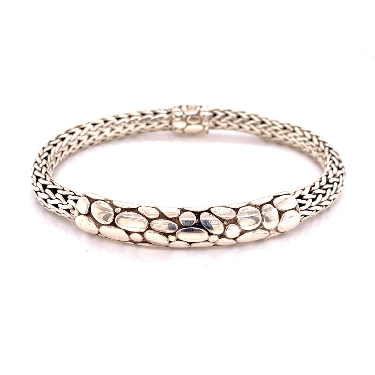 Sterling silver men's ID style bracelet by John Hardy. The bracelet measures 8 inches in length and approximately 10mm in width. Signed JH 925. John Hardy jewelry pouch included.