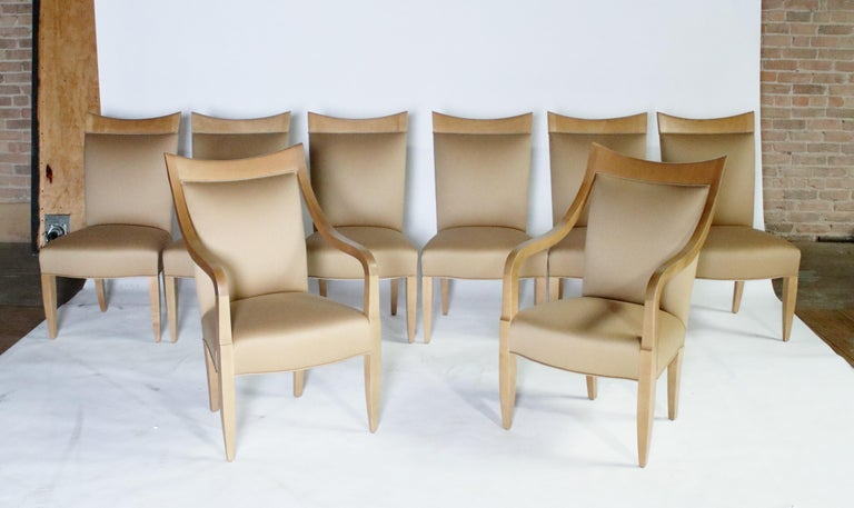 Set of 8 dining chairs designed by John Hutton for Donghia in a maple wood frame and beige color soft wool fabric in excellent condition. Set includes 2 armchairs and 6 side chairs.