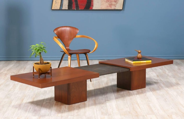 """Mid Century modern expanding coffee table designed by John Keal for Brown Saltman in the United States circa 1960's. This walnut wood coffee table extends up to 96"""" revealing a dark grey laminate surface in the center. The expandable top sits upon"""