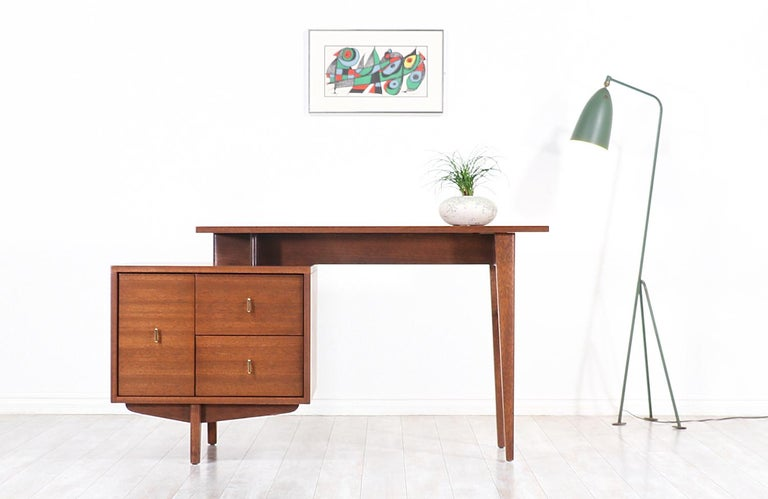 Sleek modern writing desk designed by John Keal for Brown Saltman in the United States, circa 1960s. The asymmetrical shape on this striking desk exemplifies Keal's clean and modern aesthetic ideal to represent Classic Minimalist expressions for a