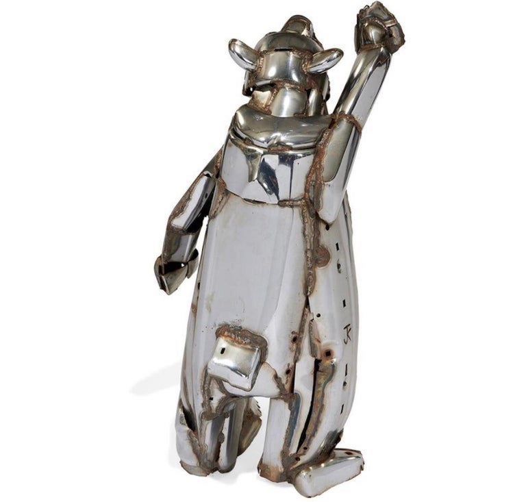 Constructed out of chromed car bumpers, signed JK in the steel. John Kearney, 1924-2014 Chicago and environs were gifted with many pieces, noteably the city's Oz Park, wherein live the Tin Man and the bronze Cowardly Lion. his work is in the