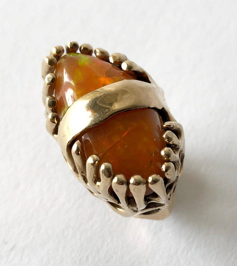 Modernist 14k gold with orange fire opal ring by John M. Morgan of Ellensburg, Washington. Brutalist, organic setting with two prong set orange fire opal pebbles.  Ring is a finger size 5.5 - 6 and weighs 25.3 grams. In very good vintage