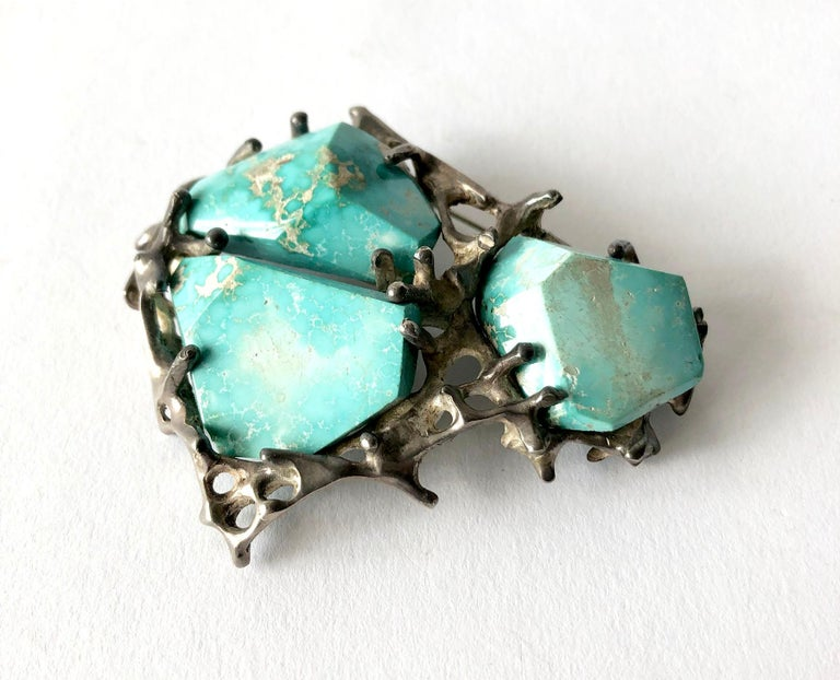 Large scale, faceted turquoise and sterling silver brooch made by John M. Morgan of Ellensburg, Washington.  Brooch measures 2.5