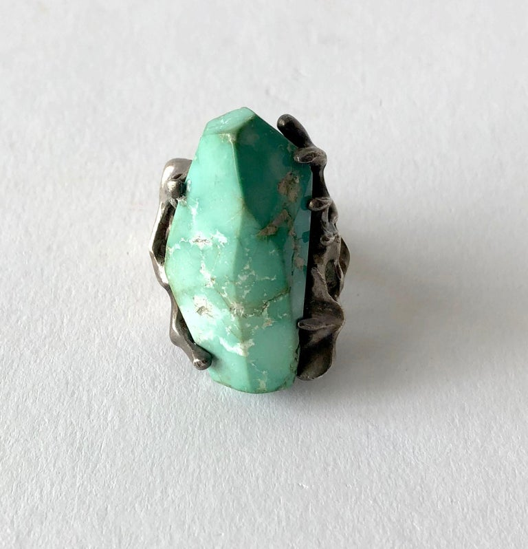 Faceted turquoise and sterling silver ring made by John M. Morgan of Ellensburg, Washington.   Ring is a finger size 7 and retains its natural, warm patina.  Unsigned.  In very good vintage condition.