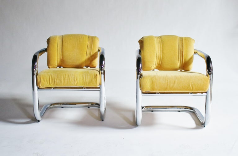 Pair of all 1970s tubular chrome cantilevered armchairs attributed to John Mascheroni with all original yellow removable cushions.