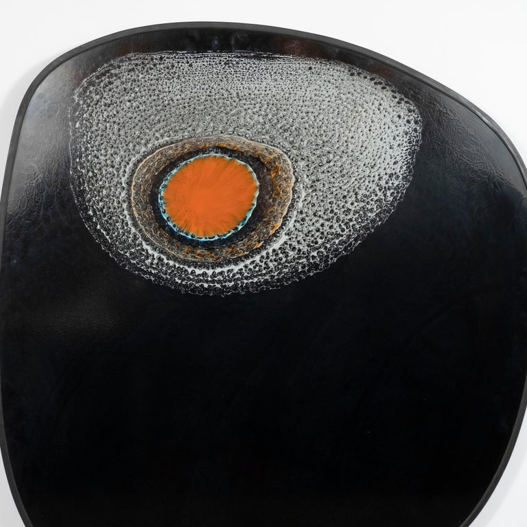 This stunning painting was realized by the celebrated abstract expressionist artist John Moyers, circa 1960. It features a orange garnet orbital form in the center ringed with turquoise surrounded by a sea of mottled of white, resembling sea foam.