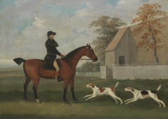 A huntsman with hounds in a landscape