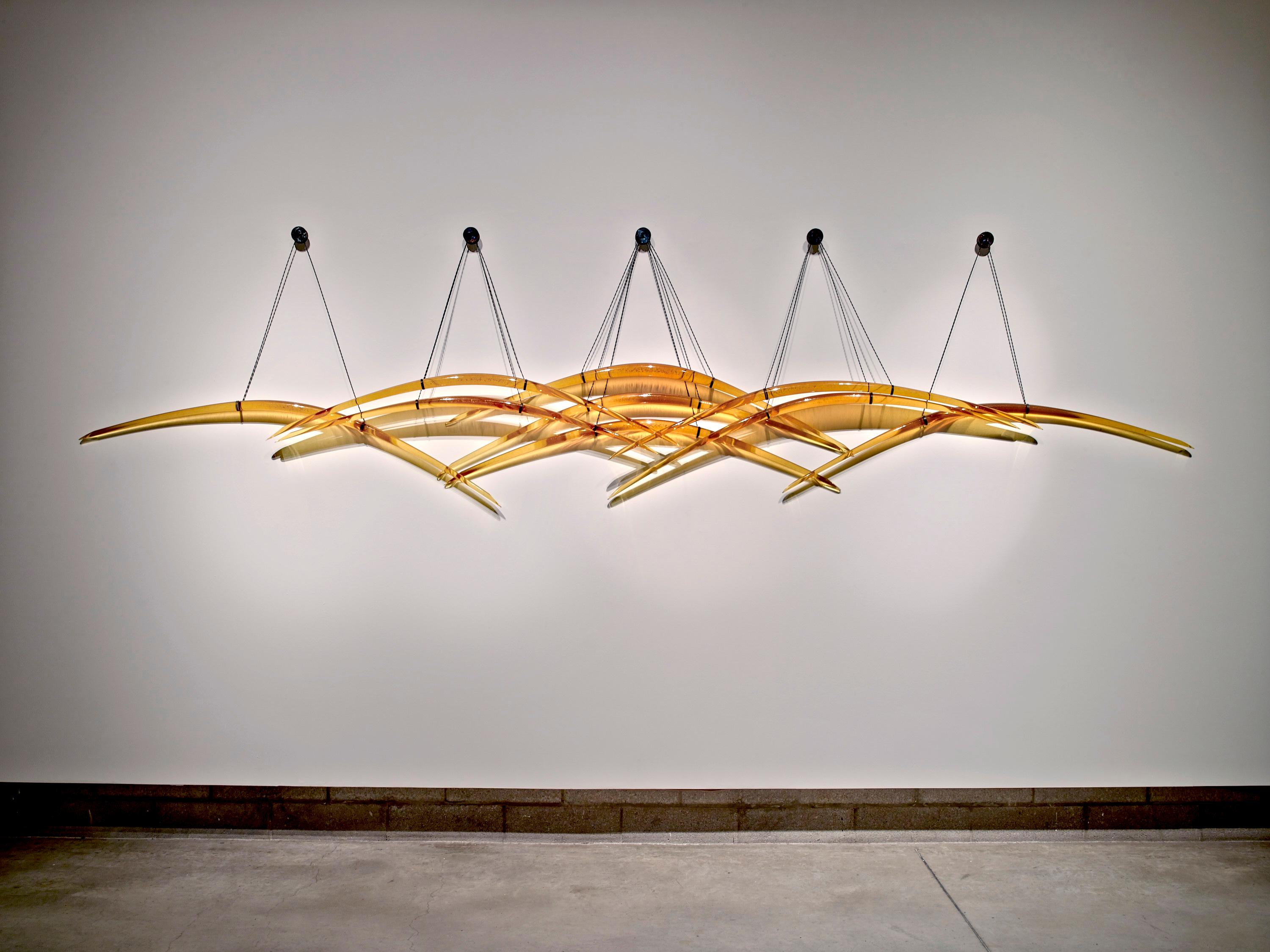 Probability - large, glass, translucent, amber yellow, suspended, wall sculpture