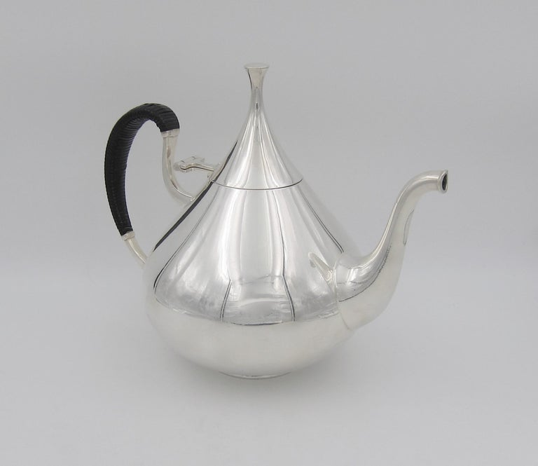 An iconic Mid-Century Modern American coffee pot designed by master silversmith John Prip (1922-2009) for Reed & Barton of Taunton, Massachusetts in 1961. The