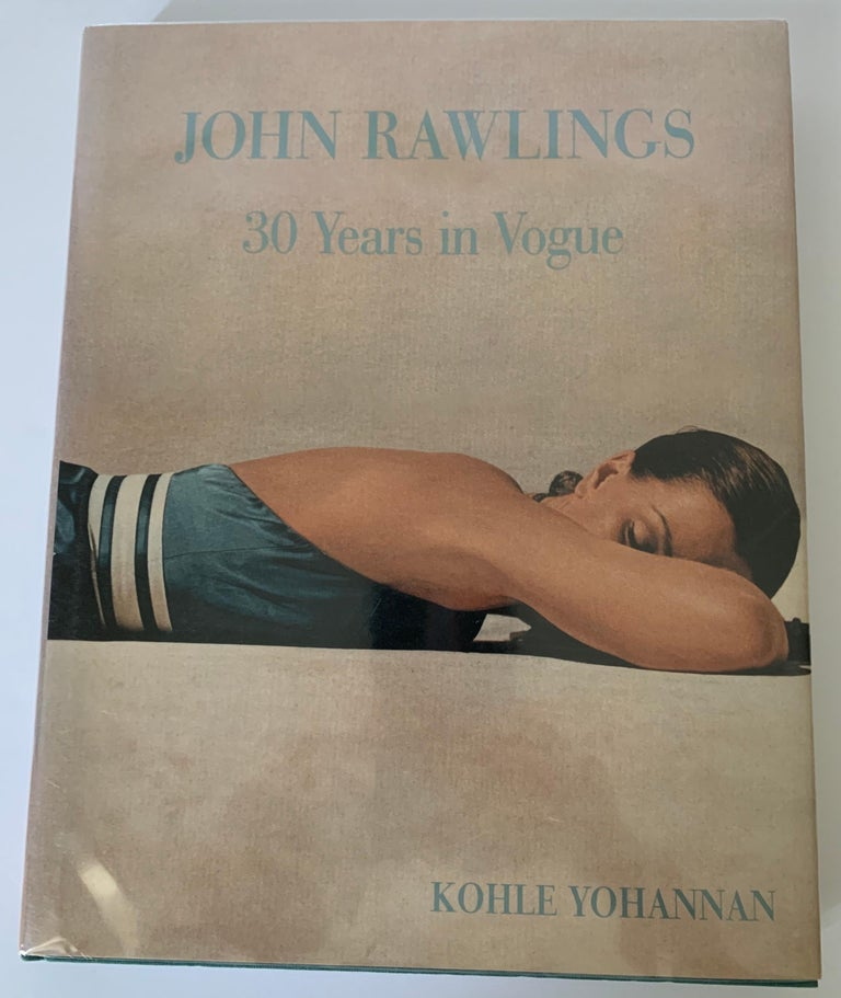 John Rawlings 30 Years in Vogue hardcover first edition. Featuring the photographs of noted fashion photographer John Rawlings and his work with Vogue magazine. Dust jacket is wrapped in Mylar.
